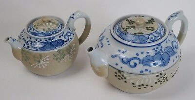 Two Japanese porcelain moriage teapots