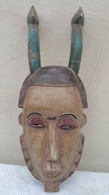 Lovely African Yaure wood mask. Fine and colourful example. Ivory Coast.
