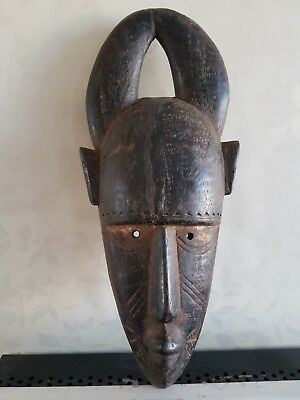 African Guro wood mask. Stylized horns. Nice example. Ivory Coast.
