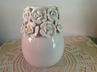 Cream Coloured Pottery Vase With Applied Hand Made Rose Design Around Top.