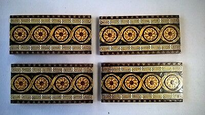 4 fireplace Tiles.   .stock item tiles Y005
