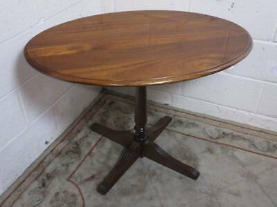 OVAL MAHOGANY PEDESTAL OCCASIONAL / COFFEE TABLE with TURNED CENTRE SUPPORT.