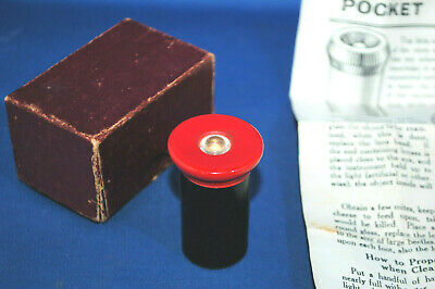 A vintage pocket microscope, original card box and instructions, red painted top
