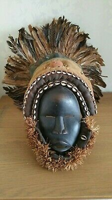 Colourful African Dan Deangle wood mask with headdress. Ivory Coast.