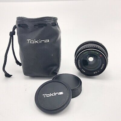 Tokina RMC 24mm f/2.8 Lens with Caps & Case