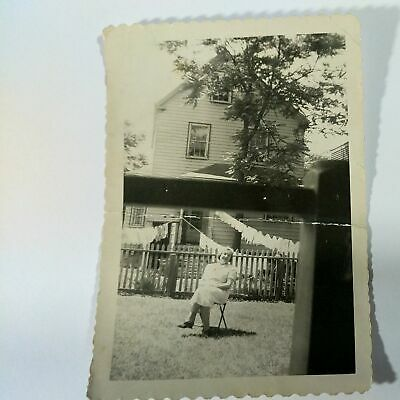 Vintage Photo Of Woman Sitting On Lawn