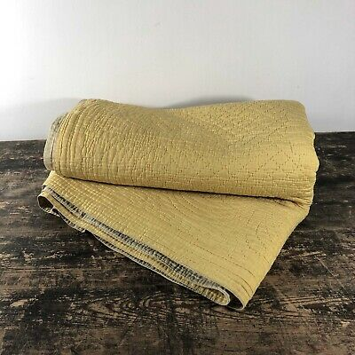 Large yellow and tan antique hand stitched Durham quilt