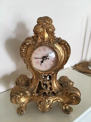 Desk, Mantel & Carriage Clocks Madame Posh Ornate Gold Coloured Resin Table Clock with a Distressed Look.