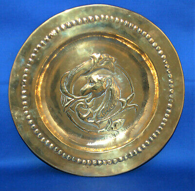 An antique medieval, gothic, gryphon, griffin, dragon dish, bowl, platter, brass