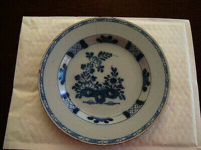 18th Century delft tin glaze plate with floral images and hatched border  20/132