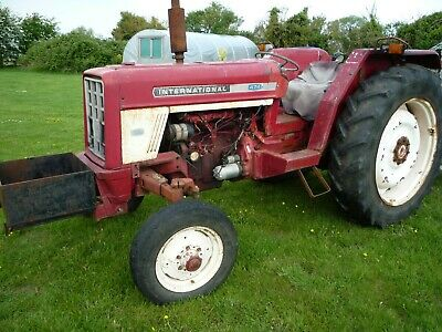 Classic 1970s tractor and finishing mower.