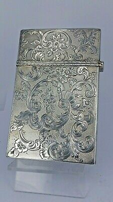 A large heavy ailver 1849 Victorian solid silver ornate visiting card case