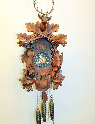Old Large Clock Cuckoo Wall Clock Black Forest wit Carillon music box 42 cm hg.
