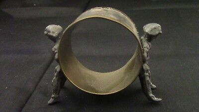 figural napkin ring of 2 young boys hold up a ring between them