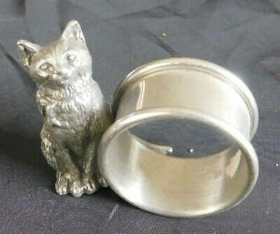 Figural cat sitting next to napkin ring