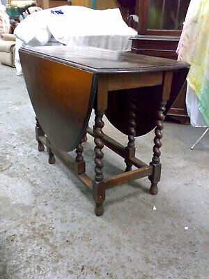 Antique oak gateleg drop side barley twist dining table