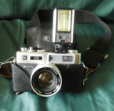 Yashica Electra 35 mm camera with extra lens and Flash