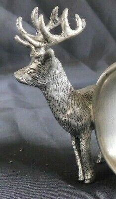 Pewter Figural deer with antlers next to napkin ring