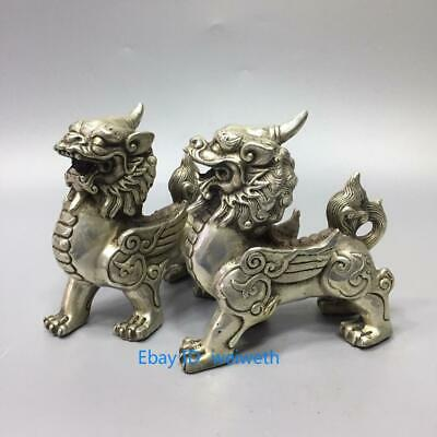 a pair Old Chinese Tibet Silver Hand Carved Dragon Beast Kirin Statue