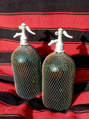 Lot of Two Vintage Soda Siphon Bottles with Wire Mesh Metal around Glass