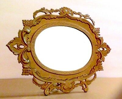 Victorian ornate vanity mirror gold cast metal beveled glass free standing