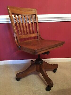 Antique vintage solid oak armless rolling swivel banker office desk Chair
