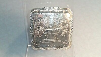 A 1871 Dutch silver square peppermint box with floral decoration to the front