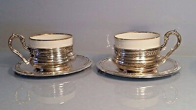 Pair of Bavarian silver cup holders & saucer together with inset cup