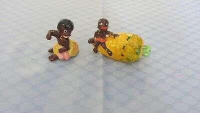 Vintage Retro Black Boy and girl one sitting on carrot Salt Pepper Shakers