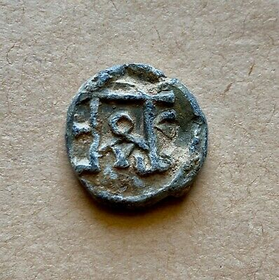 BYZANTINE LEAD SEAL/ BYZANZ SIEGEL WITH BLOCK MONOGRAM IN EITHER SIDE (6th cent)