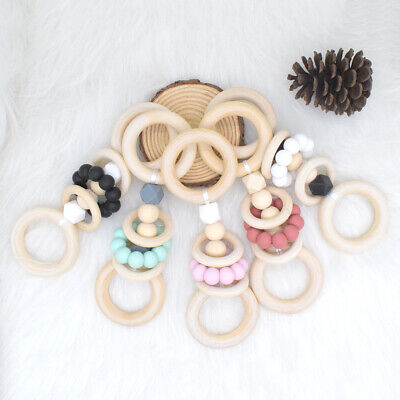Baby Sensory Chew Teether Silicone Beads Wooden Ring Teething Rattles Pram Toys