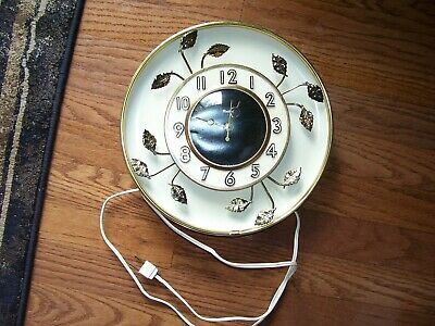 vintage retro United wall clock model 45 with metal gold leaf design electric
