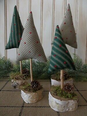 Gathering of Four Primitive Christmas and/or Winter Trees On Dried Birch Rounds