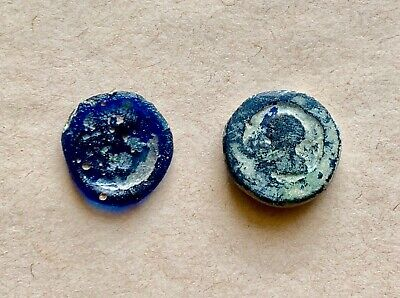 A lot of 2 Roman/Byzantine glass pendants or weights. Nice items!