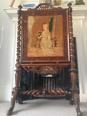 A Victorian walnut fire screen with tapestry panel 115cm