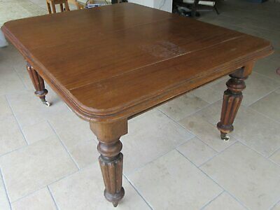 Mahogany dining table with extension leaf.  Turned legs.    Antique