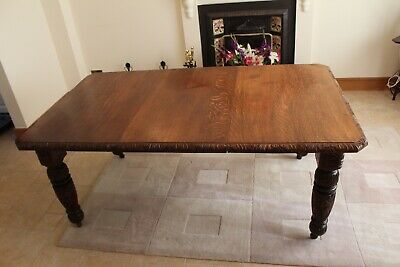 Antique oak dining table with carved edge and legs