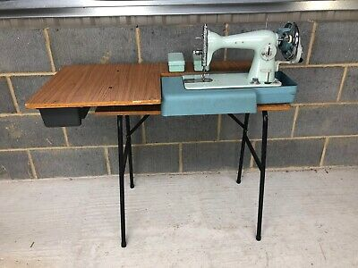 Jones Manual Sewing Machine with a folding table and extras Vintage