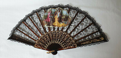 Vintage 1980s hand held Spanish fan - brown sticks with lace leaf