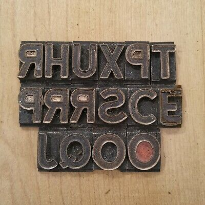 Collection of vintage brass/bronze print blocks - letters, numbers - industrial