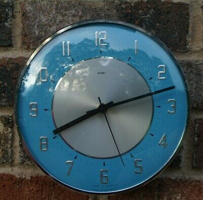 METAMEC turquoise kitchen wall clock.