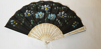 Vintage 1980s hand held fan - white sticks and black fabric hand painted leaf