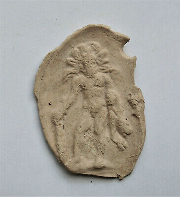 Rare clay BULLA depicting Helios, holding CLUB and HUNTED RABBIT