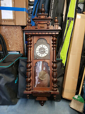 antique wall clock in need of restoration