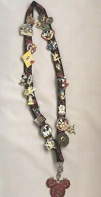 Disney Trading pins Lanyard 2007  With 21 pins , some cast member exclusive pin