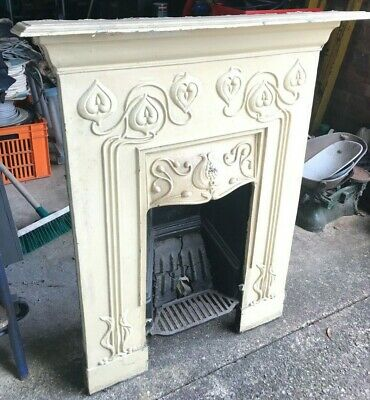 A late 19th/early 20th century cast iron fireplace surround
