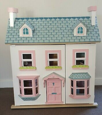 Wooden Doll House with furniture.