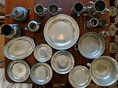 Antique pewter collection including plates, serving dishes, mugs, and pitchers