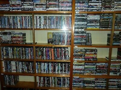 REDUCED! DVD Library over 1,000 dvd's in Glass front display cases in real wood.