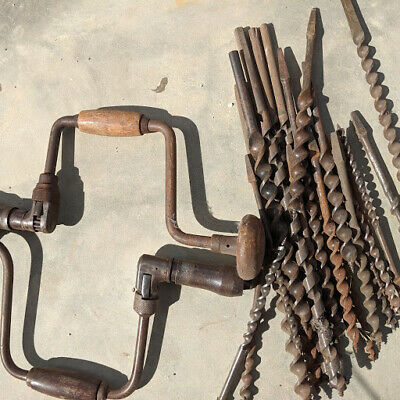 Old wood tool two hand drills and a number of drill bits